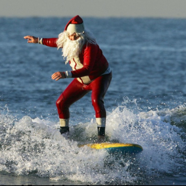 Go Surfing Dressed as Santa Clause
