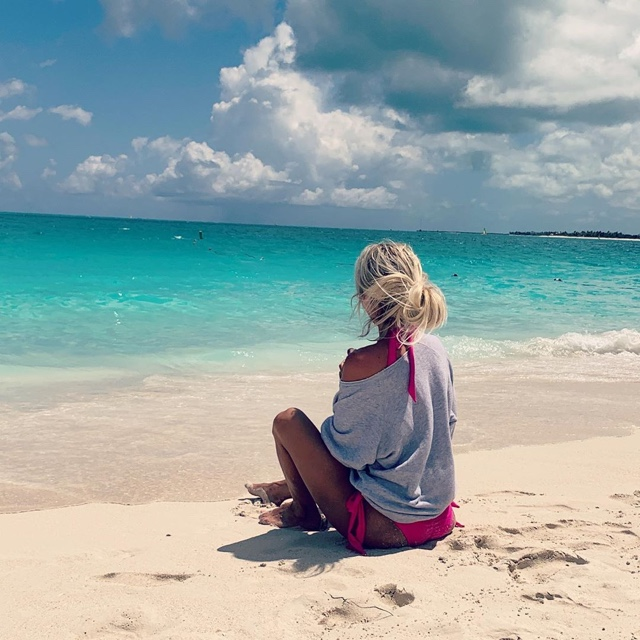 Sunbathe on Grace Bay